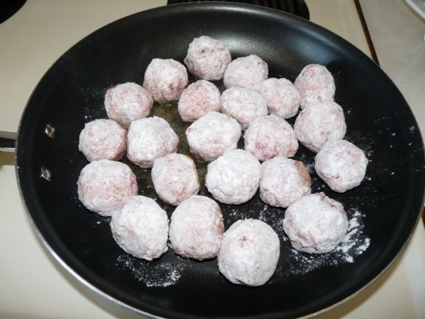 Then roll the balls in flour