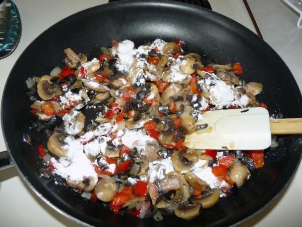 Sprinkle flour over veg and mix well