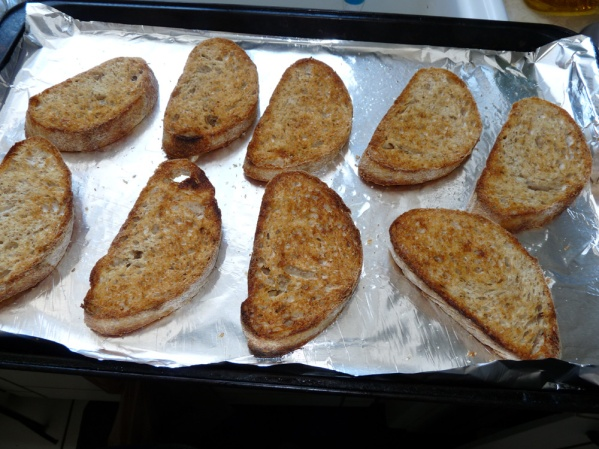 Brush the bread with olive oil and dust with salt and pepper, then toast in the oven
