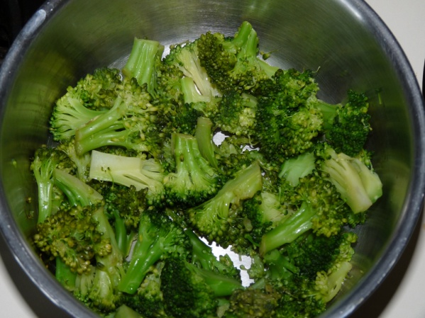 Steam the broccoli in an inch of water until tender