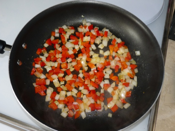 Saute the onions and red peppers