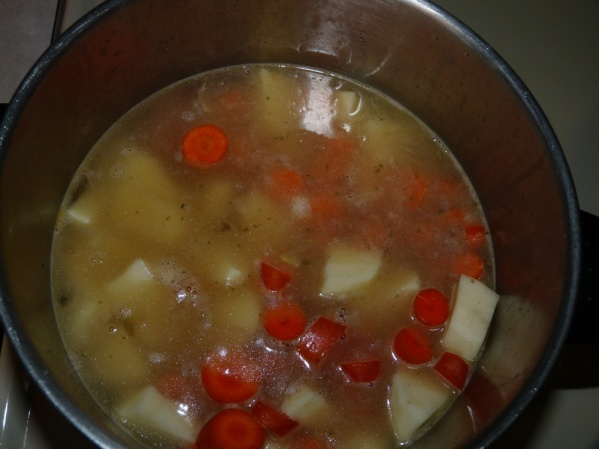 Add broth, potatoes and carrots and bring to a boil