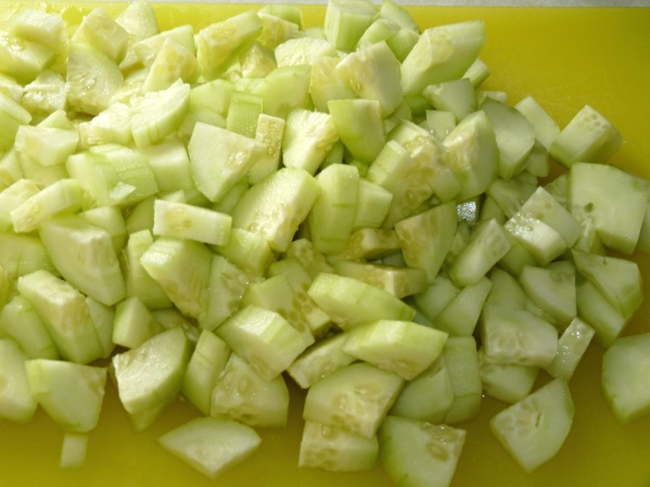 Peel and dice the cucumbers