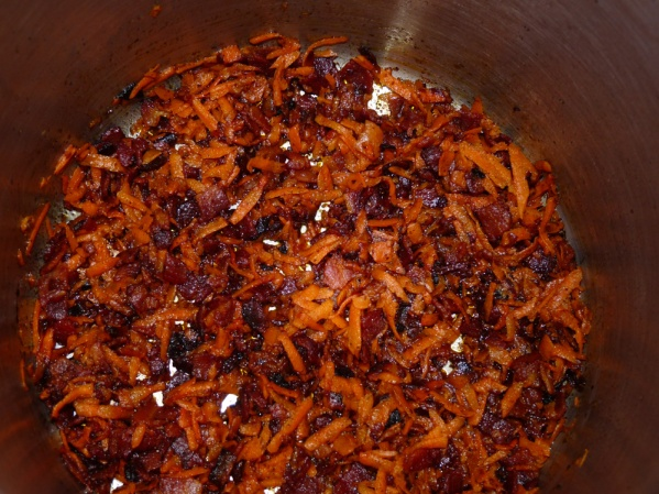After the bacon is browned and crisp, saute the carrots