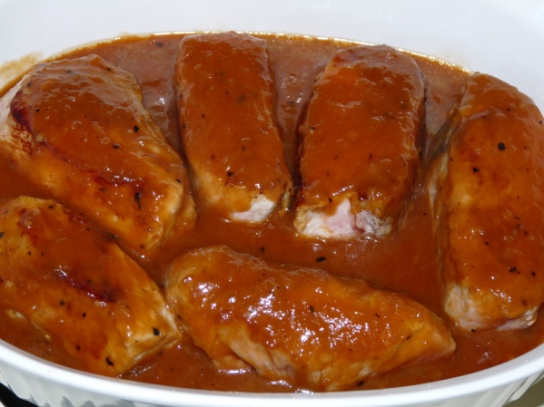 Place ribs in ovenproof dish, cover with sauce