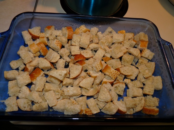 Spray baking dish and spread out baguette cubes