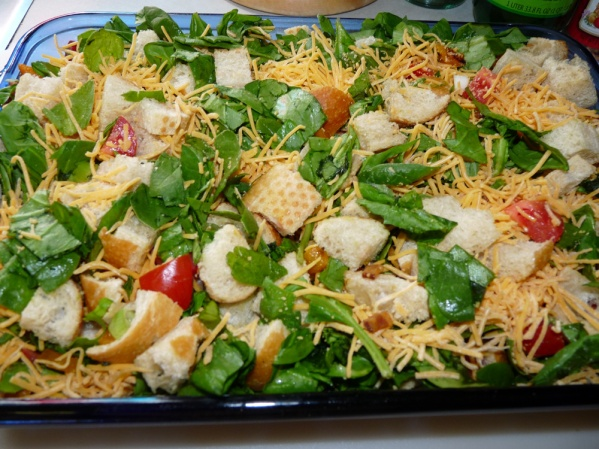 Layer spinach and shredded cheddar, then mix it up