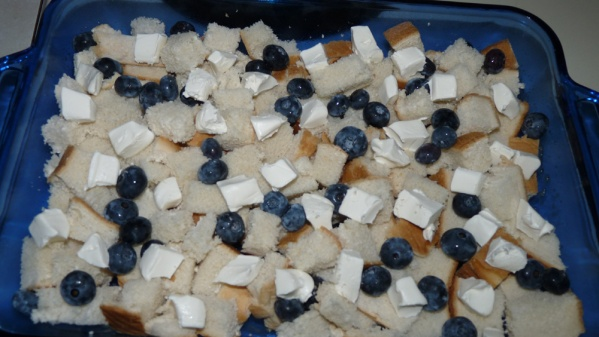 Layer half the bread cubes, blueberries, then cream cheese