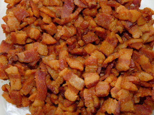 Fry diced bacon until crispy and brown