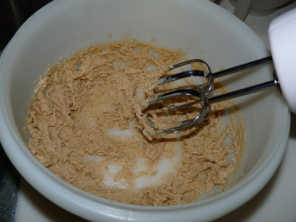 With the mixer, beat the butter, sugars, vanilla and salt together