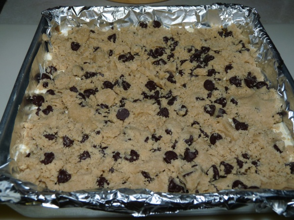 Flatten gobs of cookie dough and spread over the top of the pan