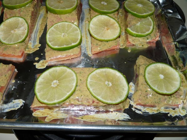 Layer slices of lemon or lime on the filets