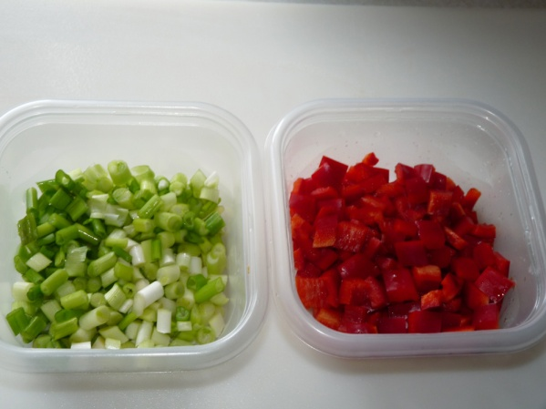 Dice 1/2 cup sweet red bell peppers and 1/2 cup green onions
