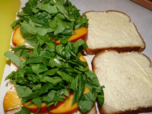Layer spinach over peaches