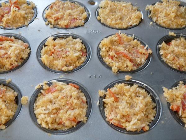 Scoop into prepared mini muffin cups and press down