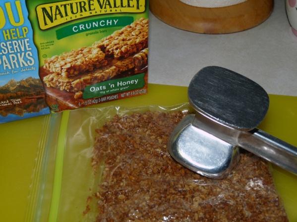 Crush granola finely