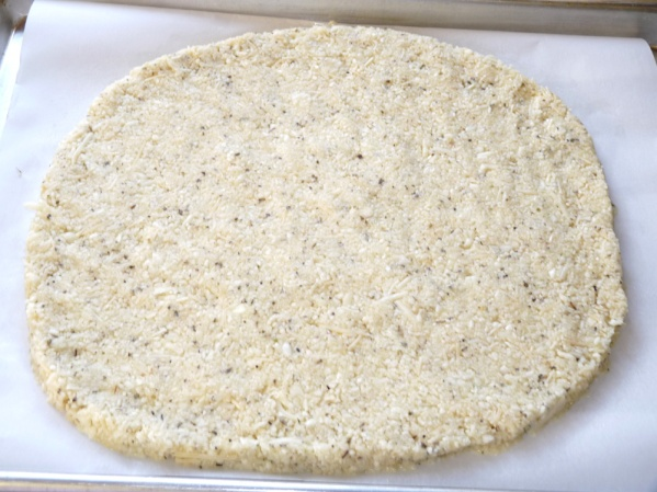 Spread dough on greased parchment paper on a sheet pan or on a silpat