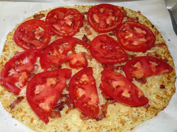 Layer thin slices of tomato