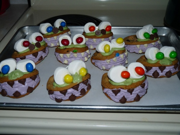 Pipe globs of frosting onto the top and set marshmallow eyes in them