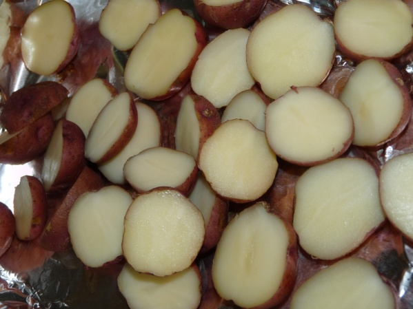Halve potatoes when they've cooled enough to handle