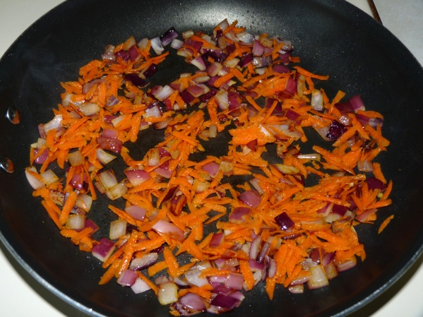 Saute onion and carrot in heated skillet