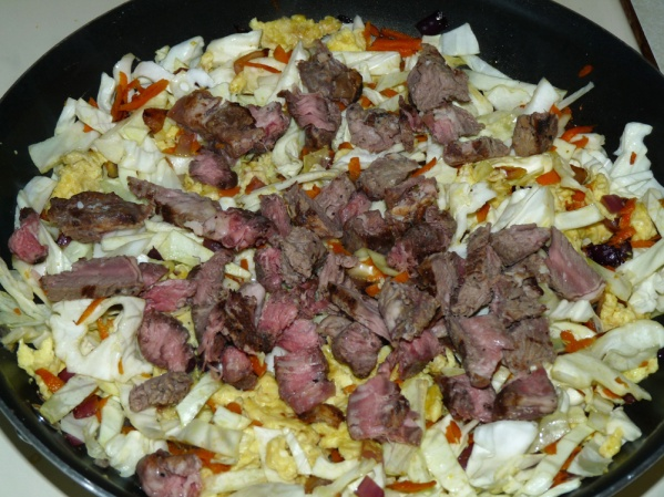 Add cabbage and steak
