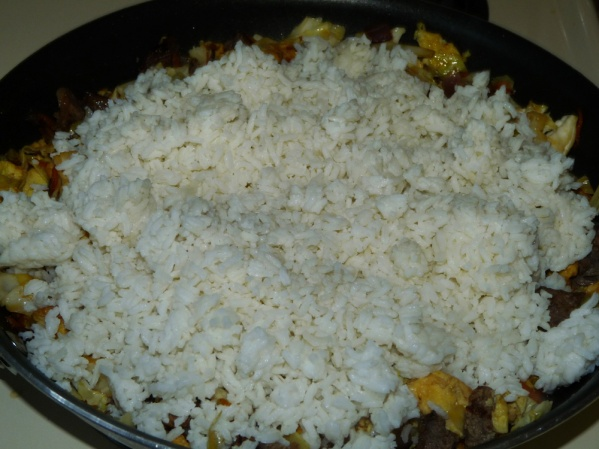 Add the rice and stir well until the rice is all separated