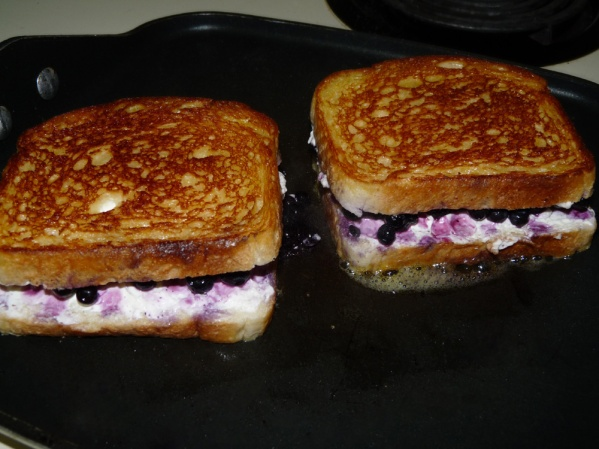 Carefully turn the sandwiches with a spatula when the first side is browned