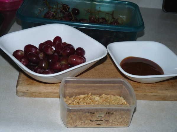 Grapes, caramel topping and crushed peanuts
