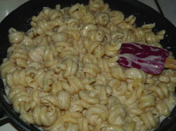 Stir pasta into sauce, adding more pasta water if necessary