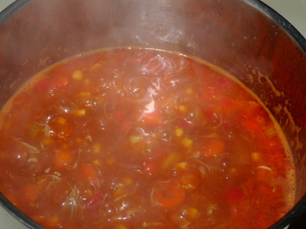 Add tomato paste and stir