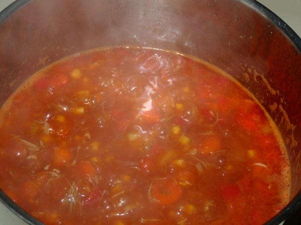 Add tomato paste and stir