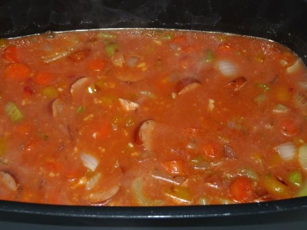 Add veggies, tomatoes, tomato paste, frozen peas and garlic powder to pot