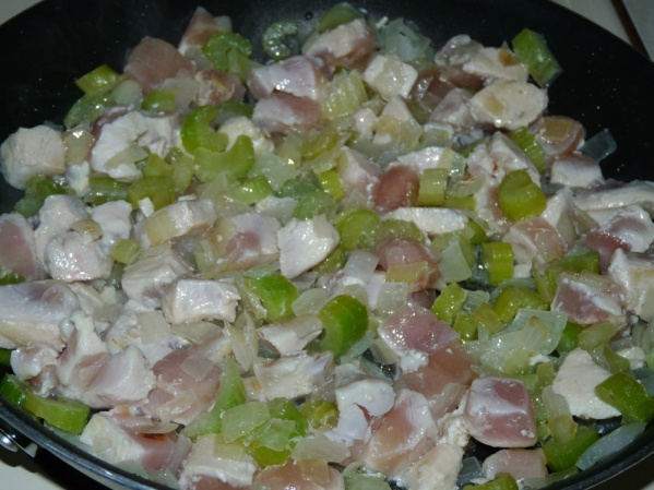 Add diced chicken breast and saute until it is no longer pink