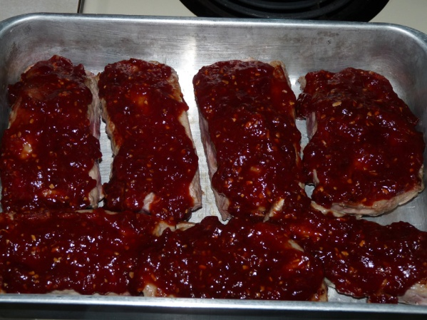Cover ribs with 1/4 of sauce, cover pan with foil and bake for one hour