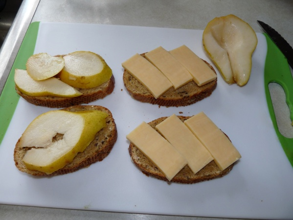 Slice pears and lay on the second slice of bread.