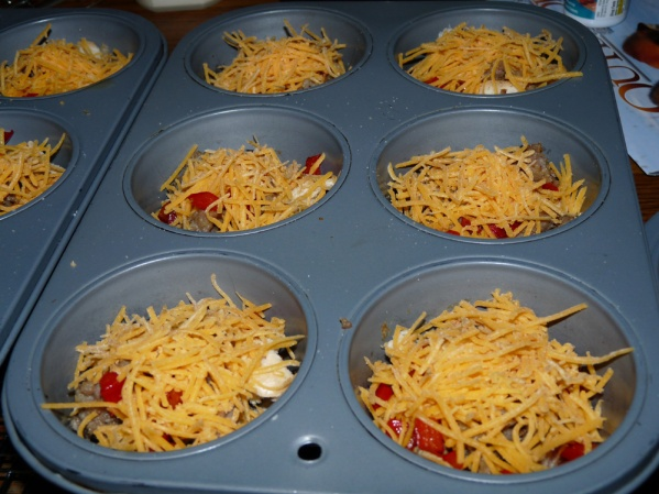 Add red pepper and cheese to the cups