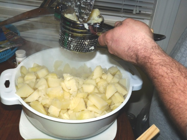 Draining the potatoes in a colander