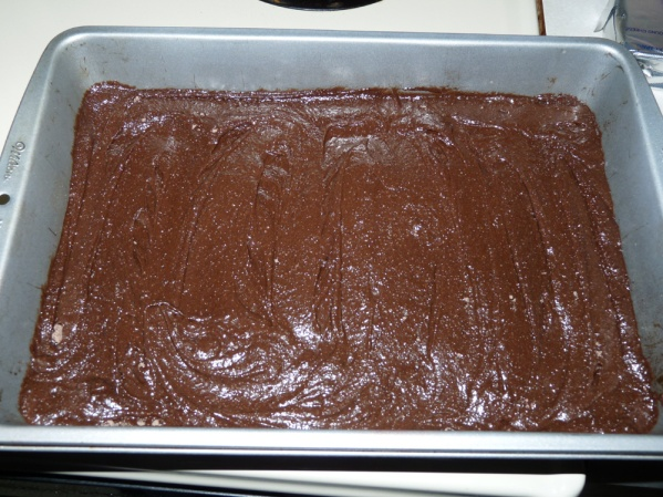 Make brownie mix according to box directions and spread into pan