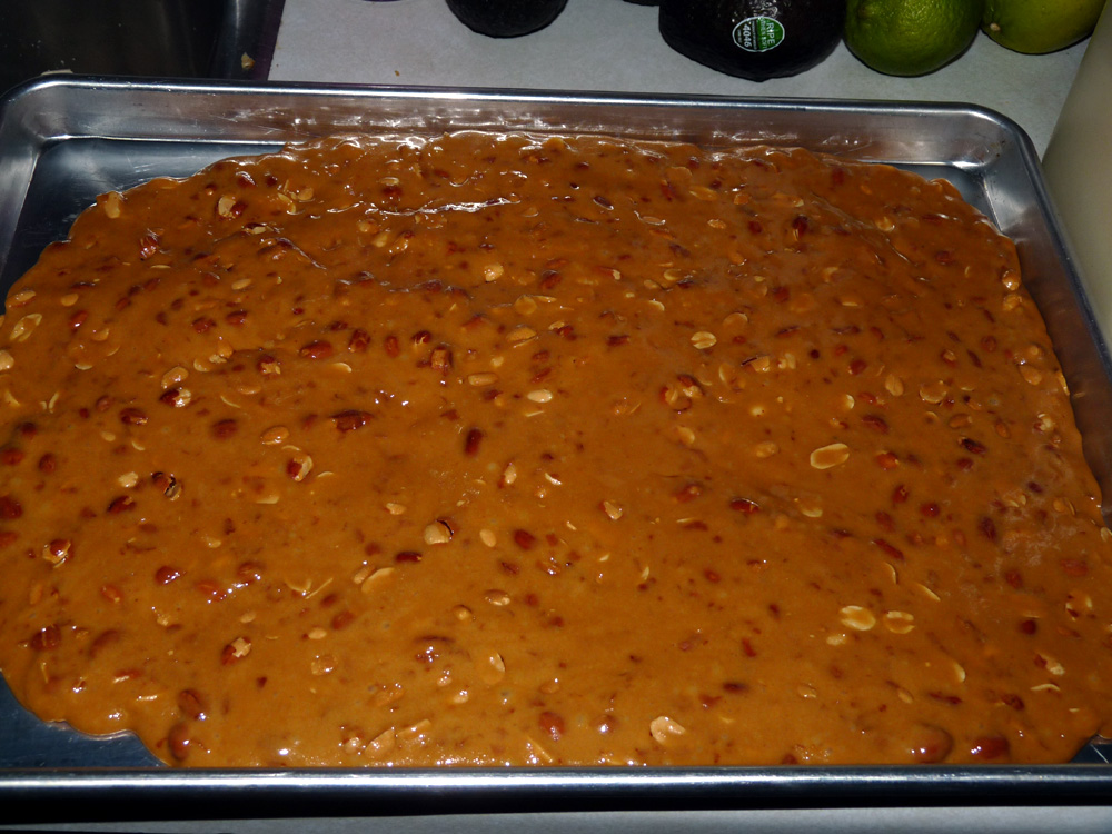 Spread brittle evenly in a sheet pan or baking sheet
