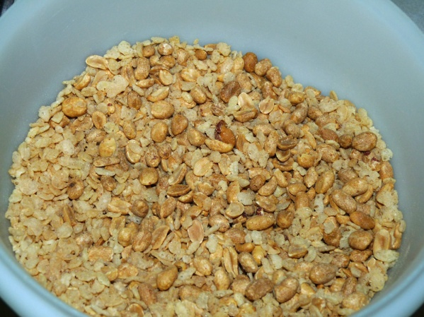 Place cereal and nuts into a large bowl