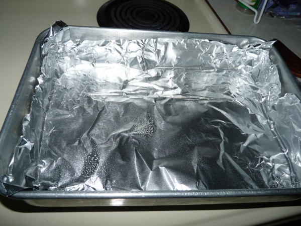 Line 9x13 pan with foil and spray with cooking spray