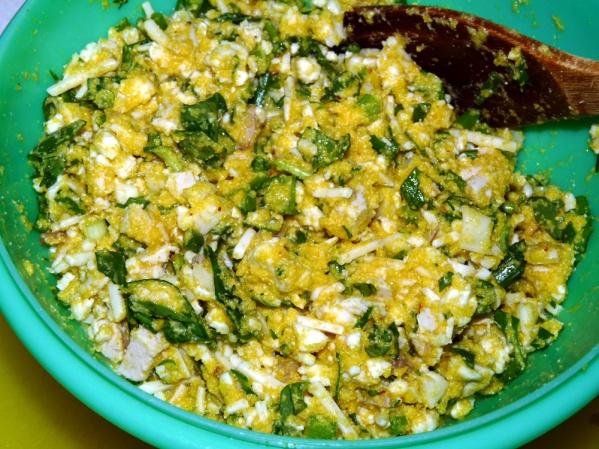 Stir veggies into the cornmeal batter.