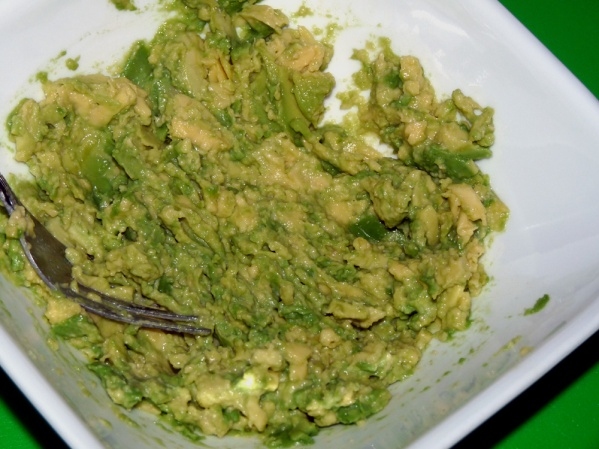 Mash avocados and lime juice with a fork
