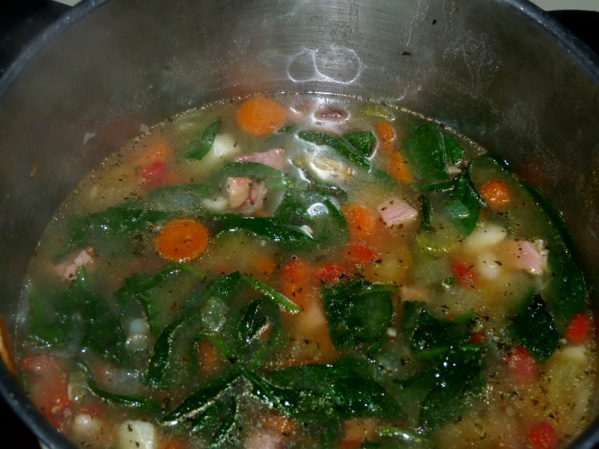 Add spinach or kale and cook until wilted.