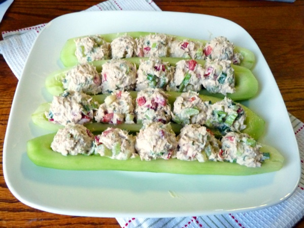 Scoop balls of tuna salad down the center of the cucumber