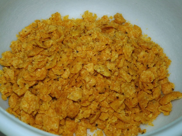 Crush the Fritos up a bit and add to the bowl