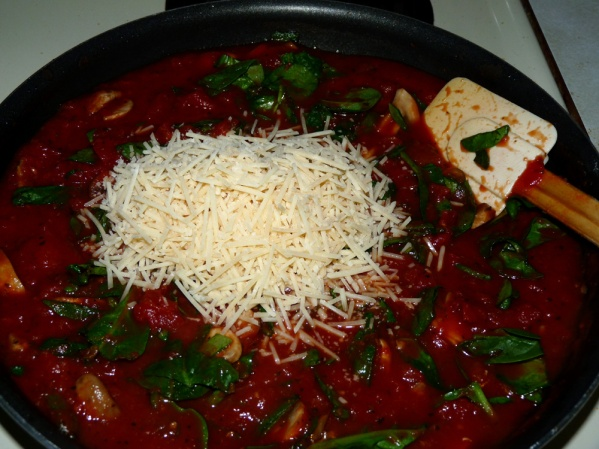 Simmer for 30 minutes, then add parmesan and spinach