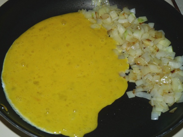 Saute onions until translucent, then scramble eggs in the same pan