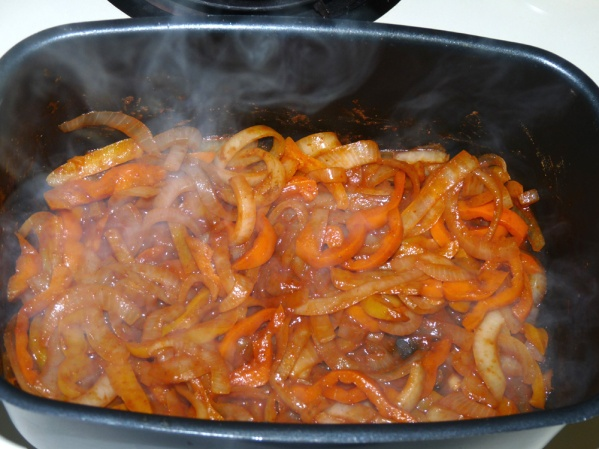 Saute onions and sweet bell peppers then add enchilada sauce